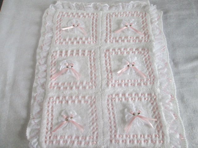 RIBBON AND ROSETTE PRAM BLANKET KNITTING PATTERN