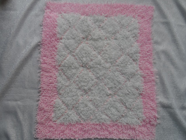 LOOPS AND RIBBON PRAM BLANKET KNITTING PATTERN